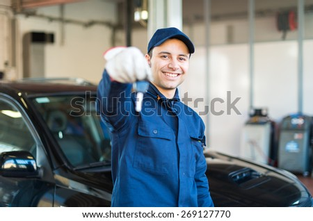 Mechanic giving you the car keys - stock photo