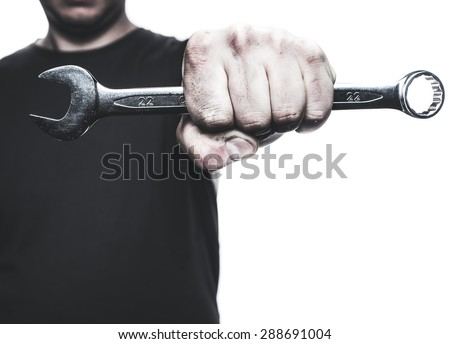 Mechanic hand hold spanner tool in hand