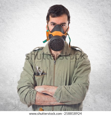 mechanic in gas mask  - stock photo