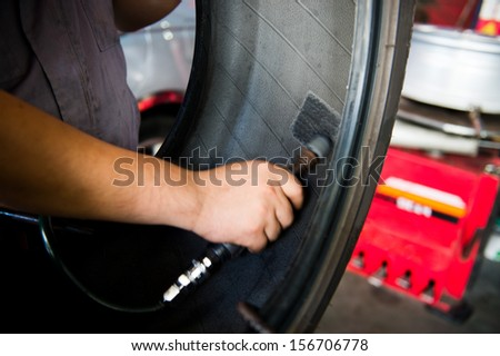 Mechanic making a patch on the rubber. - stock photo