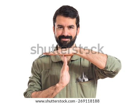 Mechanic making time out gesture   - stock photo