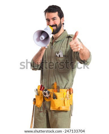 mechanic shouting by megaphone   - stock photo