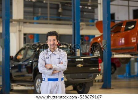 Mechanic smile at certified service garage. After Sale Service Chevrolet-Lao at Vientiane Capital, Laos. photo were taken on November 9 2016.