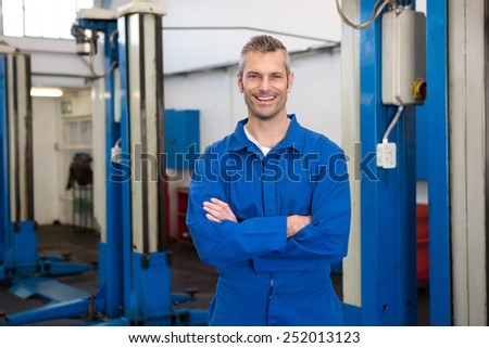 Mechanic smiling at the camera at the repair garage