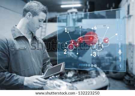 Mechanic using tablet and futuristic interface with diagram  in black and white - stock photo