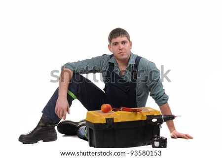 Mechanic with tools isolated on the white background
