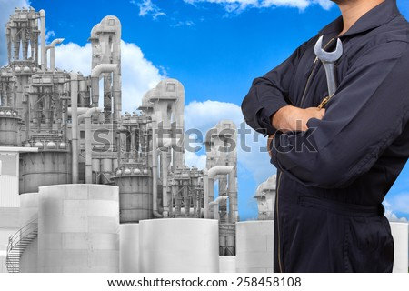 mechanic working for maintaining at petrochemical Industrial plant with blue sky - stock photo