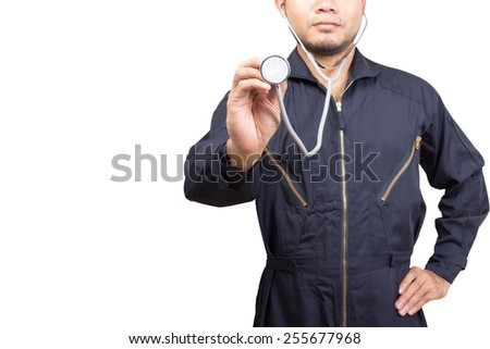 mechanic working in auto repair shop with a stethoscope isolated on white background with clipping path - stock photo