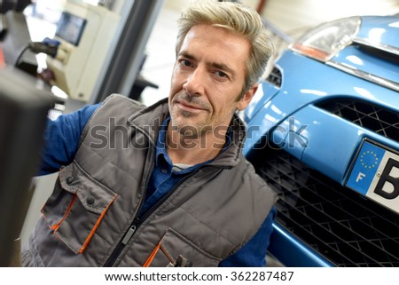Mechanic working in car repair workshop