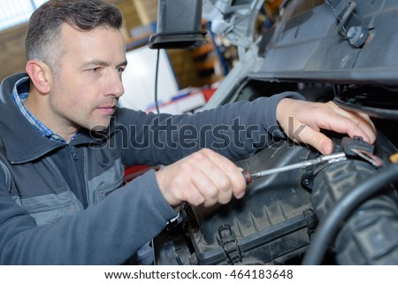 mechanic working on an engine at the repair garage