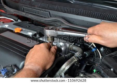 mechanic working on engine - stock photo