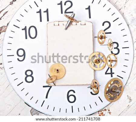 mechanical clock gears on the old wooden table