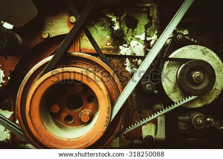 mechanical engine parts, belt,���shaft, cog, drive.  - stock photo