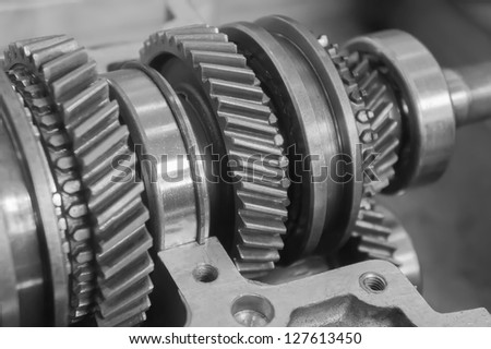 mechanical gear in black and white - stock photo