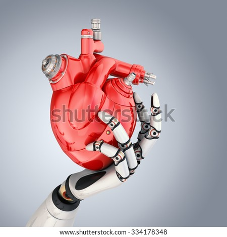 Mechanical heart in robots hand. Clipping path included - stock photo