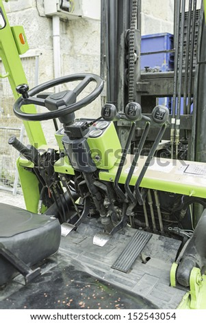 Mechanical Pallet truck and steering wheel inside car