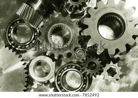 mechanical parts menagerie against steel and in a duplex brown toning concept - stock photo