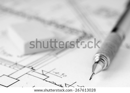Mechanical pencil and eraser on technical drawing, construction plan - stock photo
