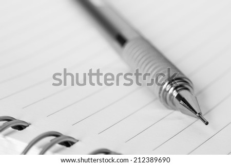Mechanical pencil on a paper - stock photo