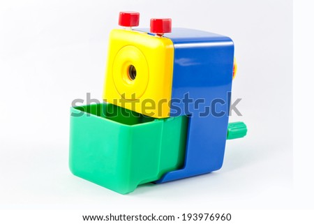 Mechanical pencil sharpener Rotate with hand blue yellow green Isolated on white background  - stock photo