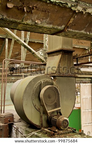 mechanical system in an old abandoned factory - stock photo