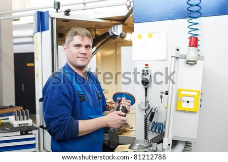 mechanical technician operative of cnc milling cutting machine center at tool workshop - stock photo