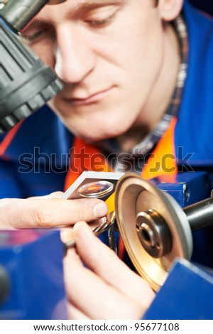 mechanical technician worker measuring detail tool after sharpening cutting machine center at workshop - stock photo
