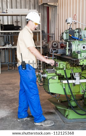 mechanical work at industrial factory - stock photo