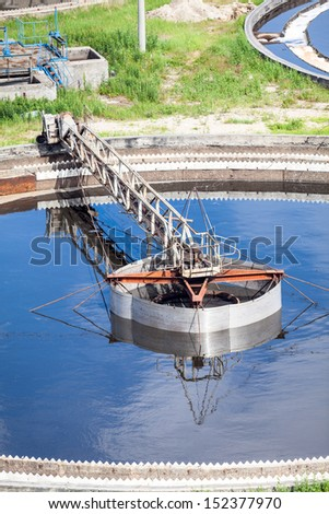 Mechanically driven scraper in sewage sedimentation tank - stock photo