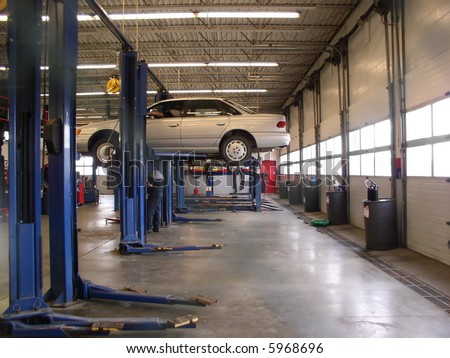 Mechanics Garage with car on hoist