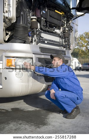 mechanics working on truck - stock photo