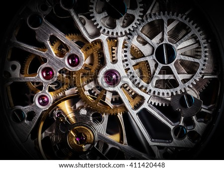 Mechanism, clockwork of a watch with jewels, close-up. Vintage luxury background. Time, work concept. - stock photo