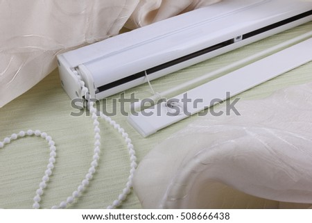 Mechanism for the roman blind on the white background.