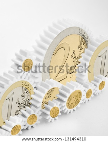 mechanism of gears with euro coins on a white background - stock photo