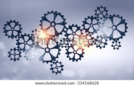 Mechanism of metal gears and cogwheels on color background