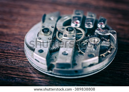 Mechanism of pocket clock with grunge texture close up. - stock photo