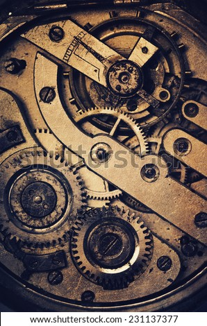 Mechanism of pocket watch with grunge texture.