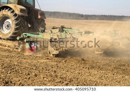 Mechanized processing of soil in spring before planting corn