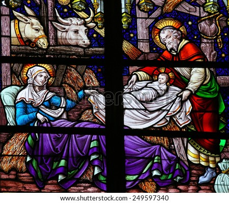 MECHELEN, BELGIUM - JANUARY 31, 2015: Stained Glass window depicting a Nativity Scene at Christmas in the Cathedral of Saint Rumboldt in Mechelen, Belgium. - stock photo