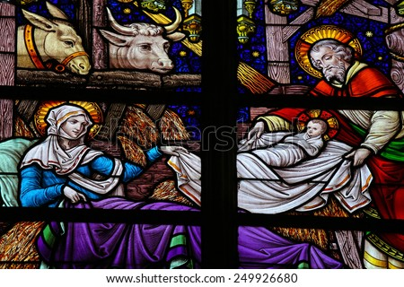 MECHELEN, BELGIUM - JANUARY 31, 2015: Stained Glass window depicting a Nativity Scene at Christmas in the Cathedral of Saint Rumboldt in Mechelen, Belgium.