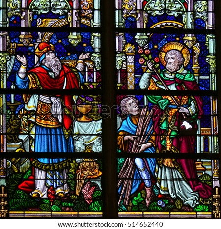MECHELEN, BELGIUM - JANUARY 31, 2015: Stained Glass window depicting a scene in the Life of Saint Joseph, in the Cathedral of Saint Rumboldt in Mechelen, Belgium.