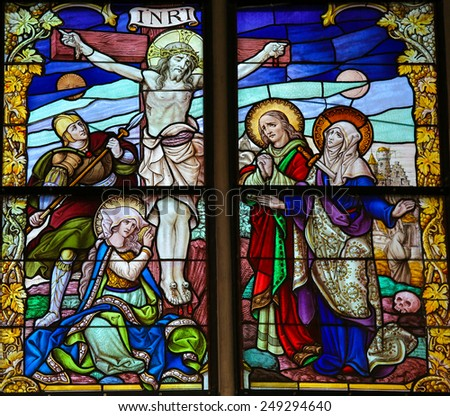 MECHELEN, BELGIUM - JANUARY 31, 2015: Stained Glass window, depicting Jesus on the Cross on Good Friday, in the Cathedral of Saint Rumboldt in Mechelen, Belgium.