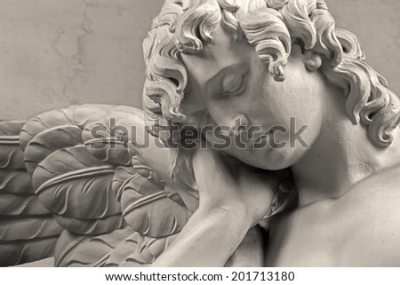 MECHELEN, BELGIUM - JUNE 14, 2014: The sorrow of angel. Detail of stone statue in church Our Lady across de Dyle.