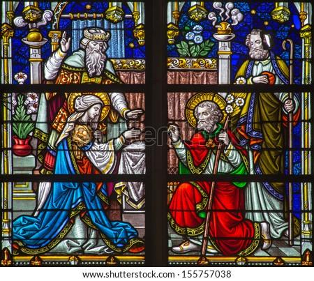 MECHELEN, BELGIUM - SEPTEMBER 6:  Wedding of Virgin Mary and st. Joseph  scene from windowpane of St. Rumbold's cathedral on Sepetember 6, 2013 in Mechelen, Belgium. - stock photo