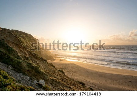 Meco beach in Portugal by sunset - stock photo