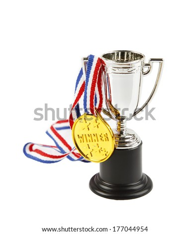 Medal and trophy on white background - stock photo