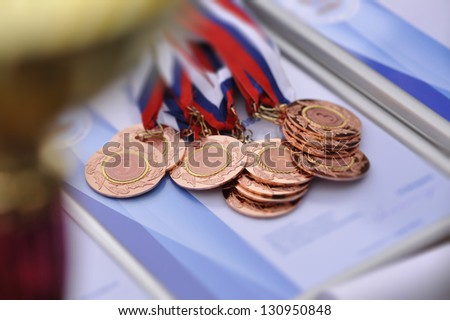 medal for the third place of the awarding ceremony. tilt-shift - stock photo