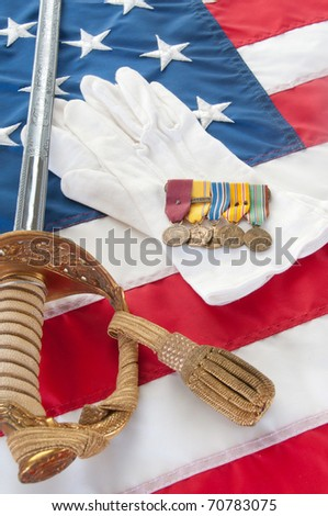 Medeals and uniform peices from World War II veteran - stock photo