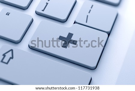 Medecine cross sign button on keyboard with soft focus