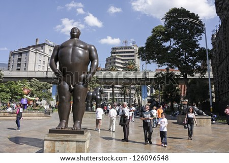 MEDELLIN, COLOMBIA - JAN 2: Botero square on January 2, 2010 in Medellin, Colombia. Launched in 2002, are displayed in the street 23 sculptures by Fernando Botero. In the picture, the statue 'Adan'. - stock photo